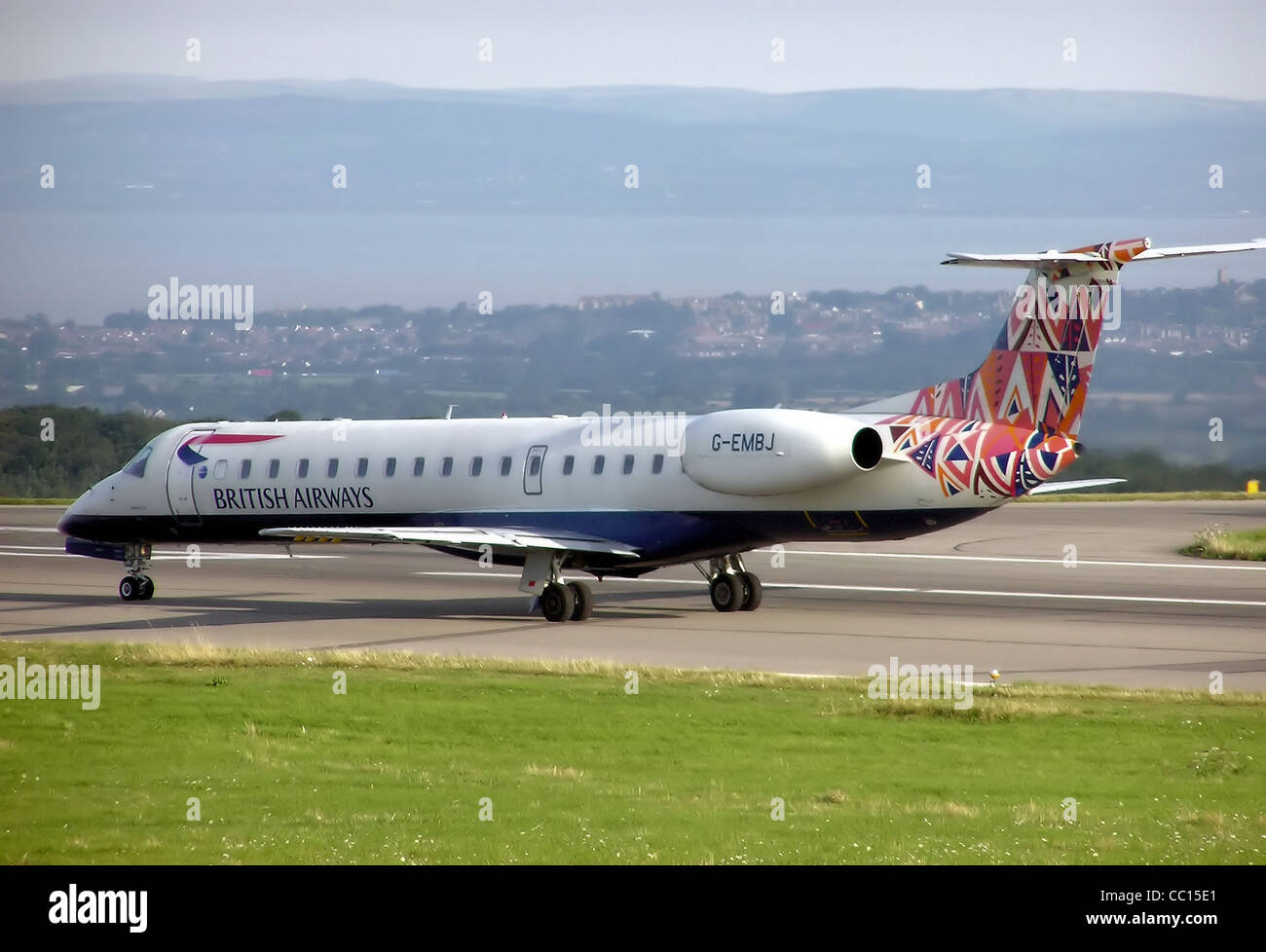 British Airways Embraer ERJ 145 (G-EMBJ) taxis at Bristol International Airport, England. - Stock Image