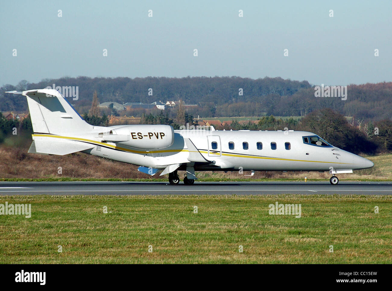 Bombardier Learjet 60 (Estonia registration ES-PVP) lands at London Luton Airport, England - Stock Image
