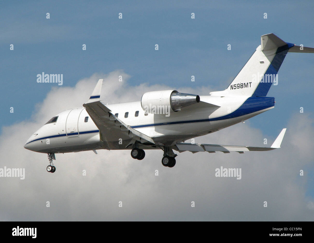 Bombardier CL-600 business jet (US registration N598MT) at London Heathrow Airport, England - Stock Image