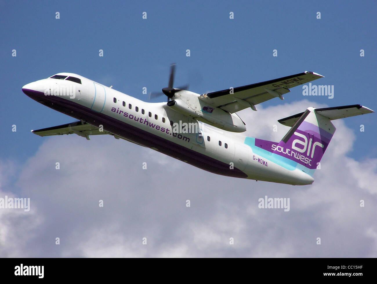 De Havilland Canada Dash 8 (G-WOWA) taking off from Bristol International Airport, England - Stock Image