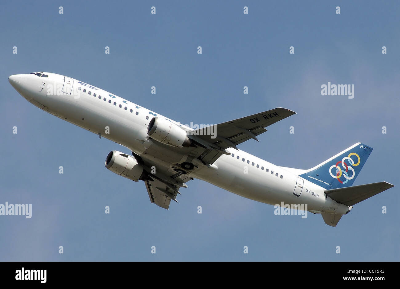 Olympic Airlines Boeing 737-400 (SX-BKH) landing at London Heathrow Airport. - Stock Image