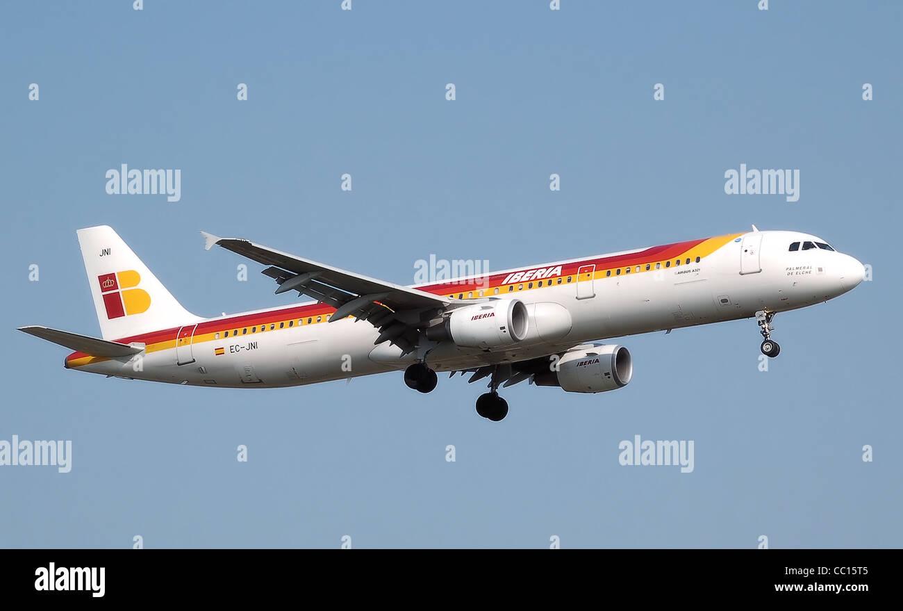 Iberia Airbus A321-200 (EC-JNI) landing at London Heathrow Airport. - Stock Image