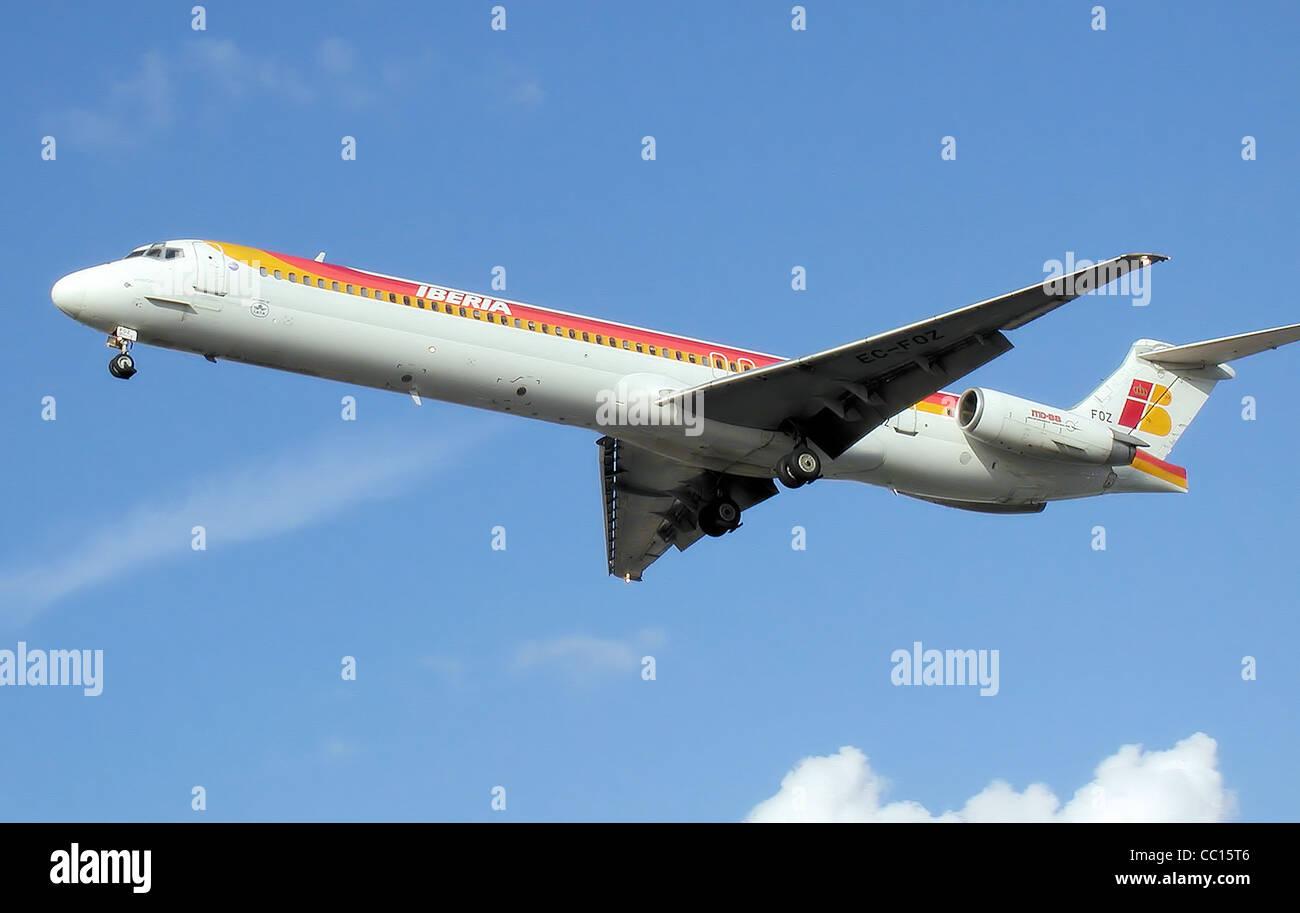Iberia McDonnell Douglas MD-88 (EC-FOZ) landing at London Heathrow Airport. - Stock Image
