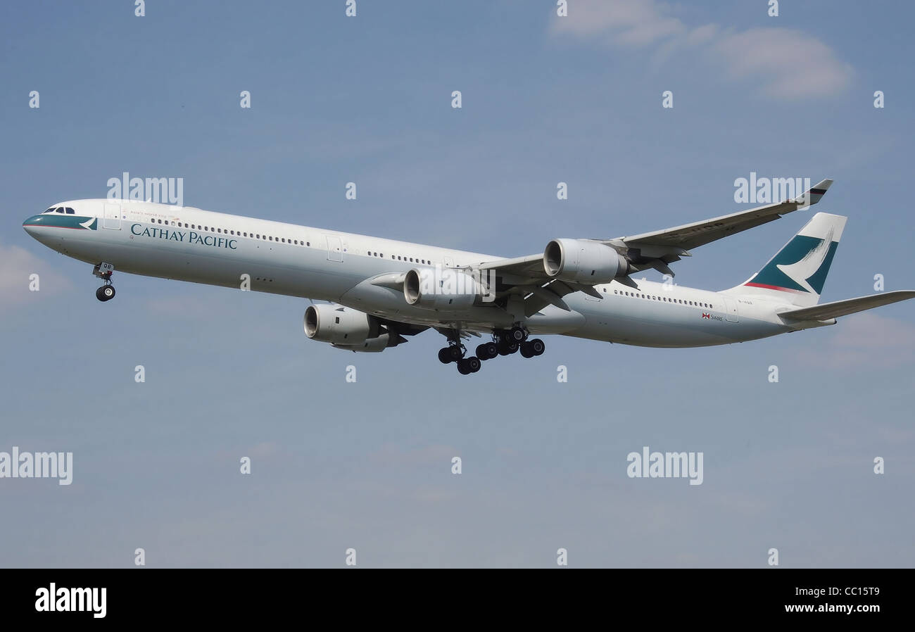 Cathay Pacific Airbus A340-600 (B-HQB) landing at London Heathrow Airport. Stock Photo
