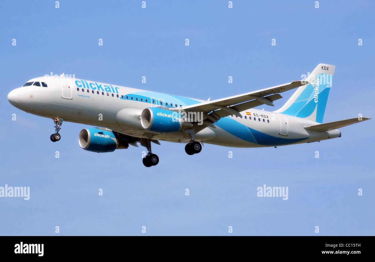 Clickair Airbus A320-200 (EC-KDX) landing at London Heathrow Airport. - Stock Image