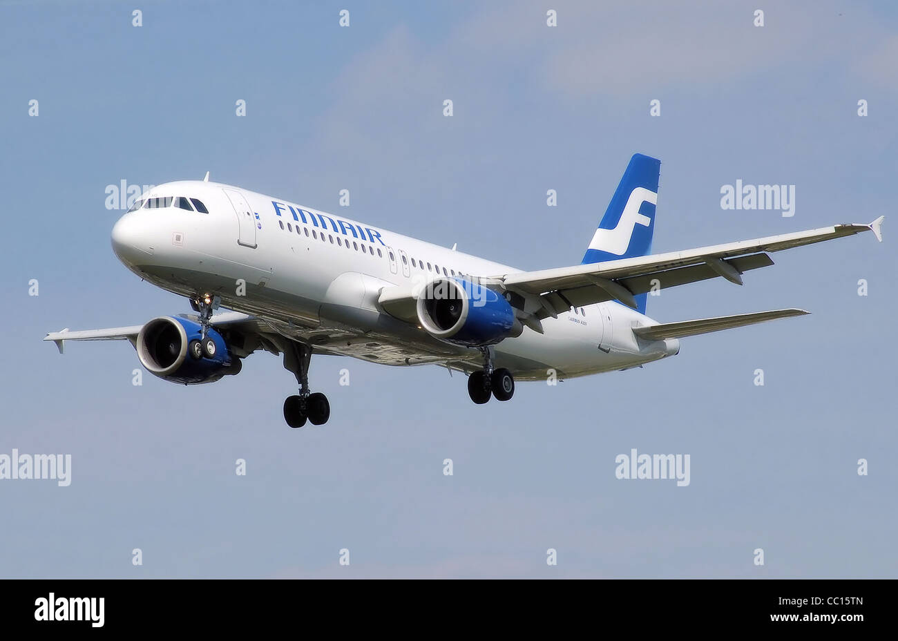 Finnair Airbus A320 landing at London Heathrow Airport. - Stock Image
