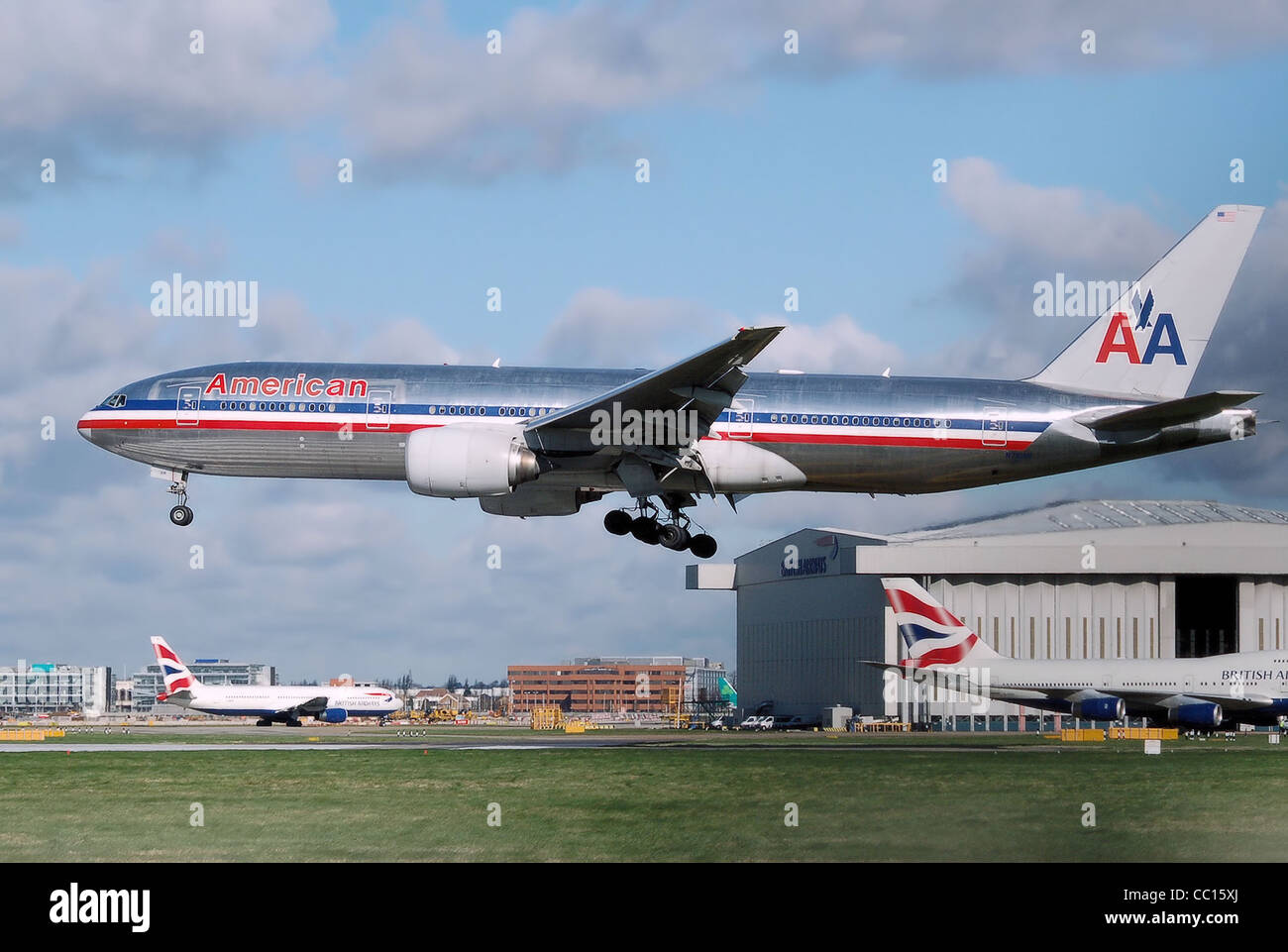 American Airlines Boeing 777-200ER landing at London Heathrow Airport - Stock Image