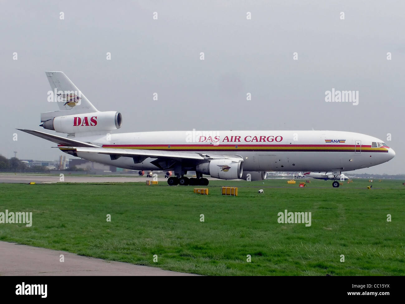 DAS Air Cargo DC-10-30 (5X-JCR) waiting for permission to take off at London Gatwick Airport, England. - Stock Image