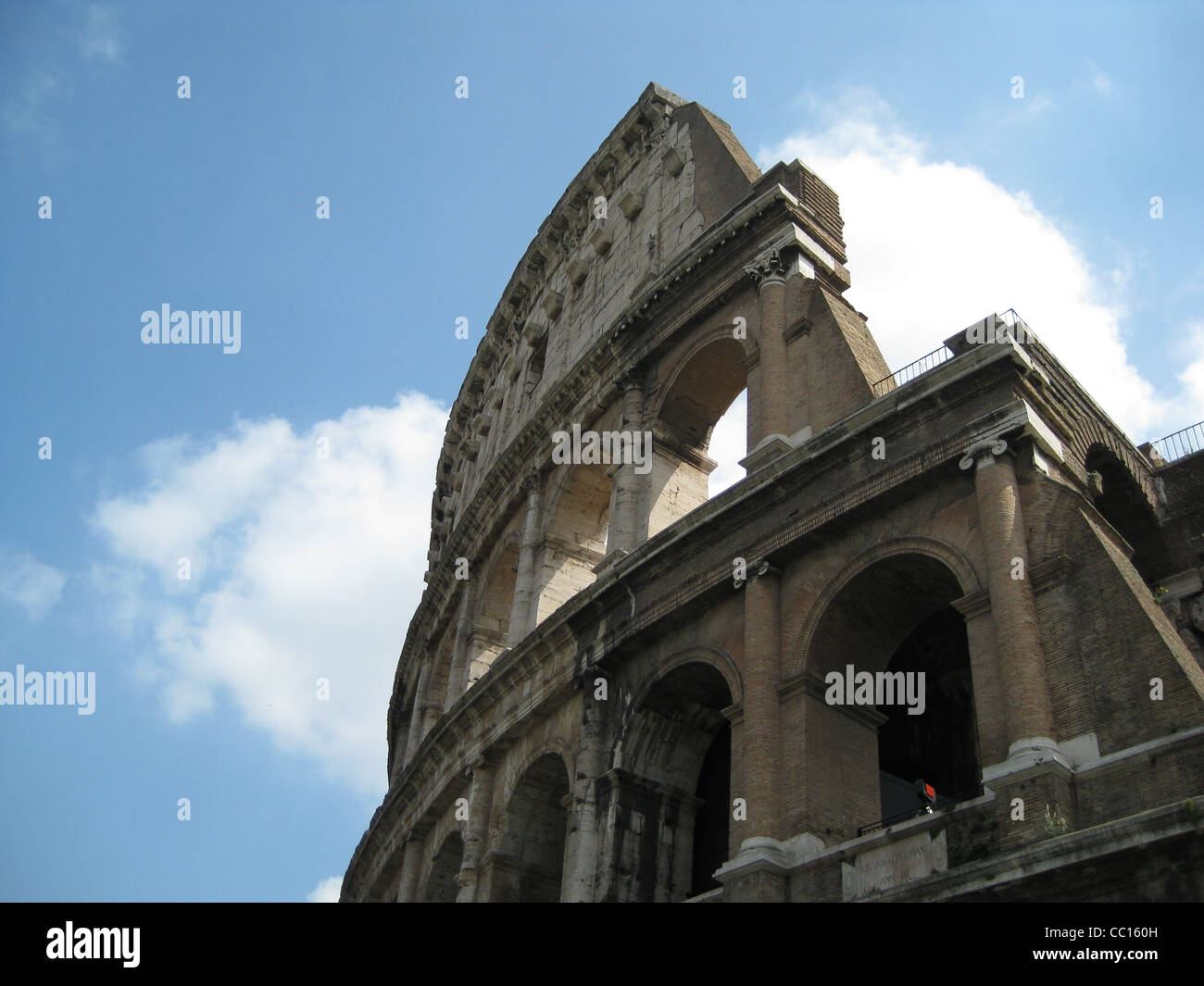 Broken wall of the Colloseum against clouds - Stock Image