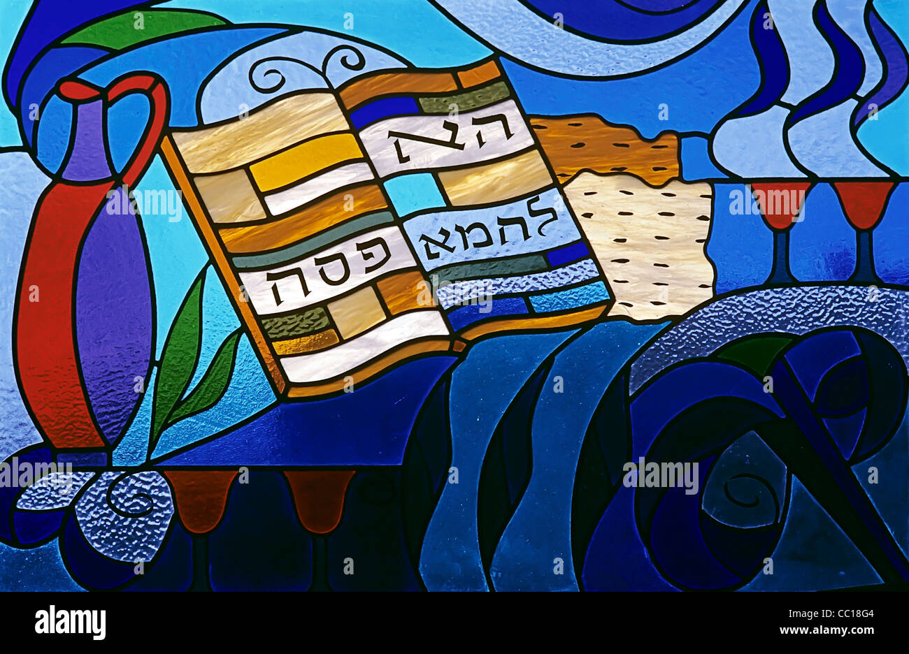 open Passover Haggadah and wine cups - objects related to Passover - stained glasses - London synagogue - UK - Stock Image