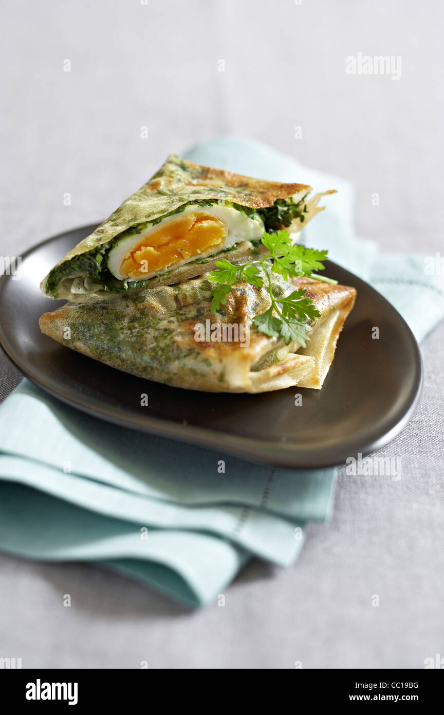 Egg and Herbs Briks - Stock Image