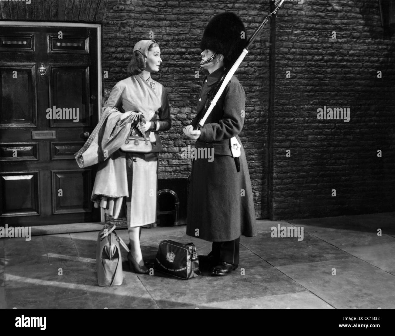 VALERIE HOBSON & GEORGE COLE WHO GOES THERE! (1952) - Stock Image
