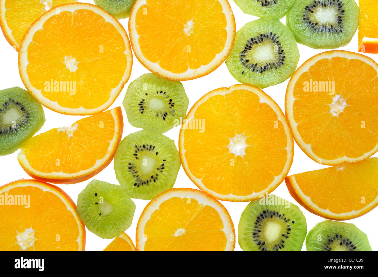 Slices of exotic fruits isolated on white - Stock Image