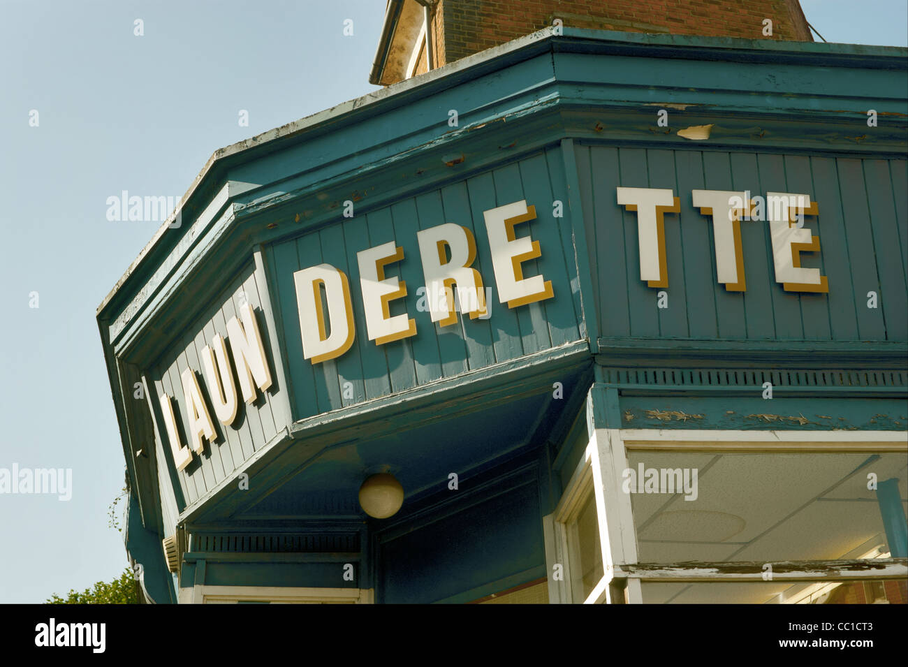 Close up of the sign over the launderette. - Stock Image