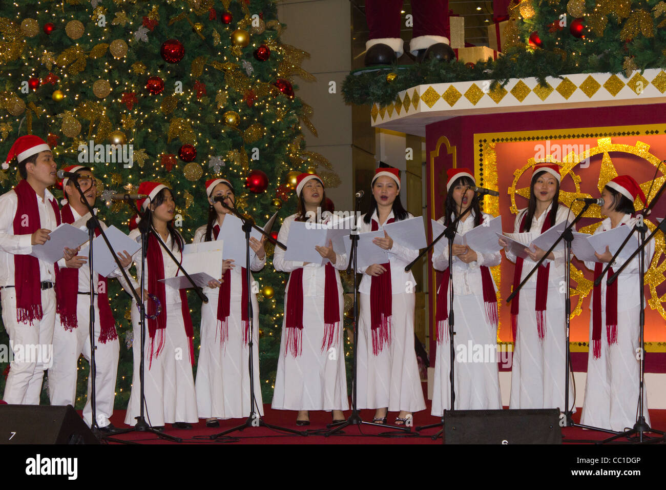 choir singing Christmas songs in Suria Mall, Kuala Lumpur City Centre, Malaysia - Stock Image