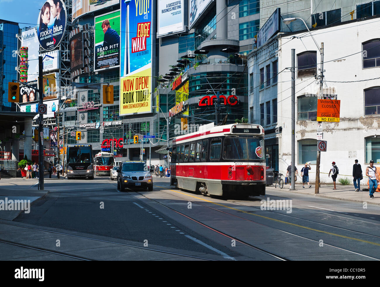 Streetcars, buses and cars on Dundas Street, near the Yonge-Dundas Square in Toronto, Ontario - Stock Image