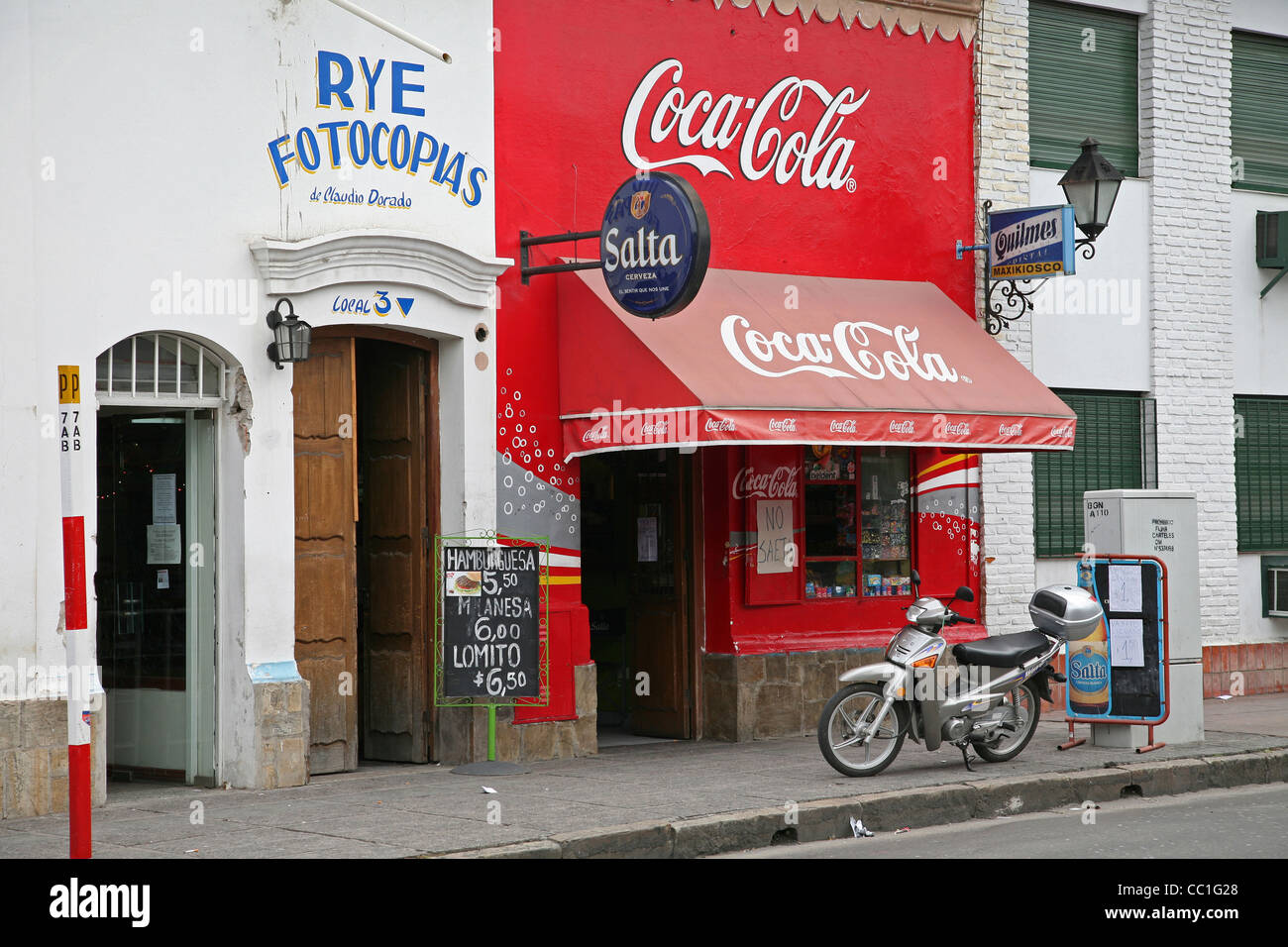 Shop with Coca Cola advertisement on façade in the town Salta, Argentina - Stock Image