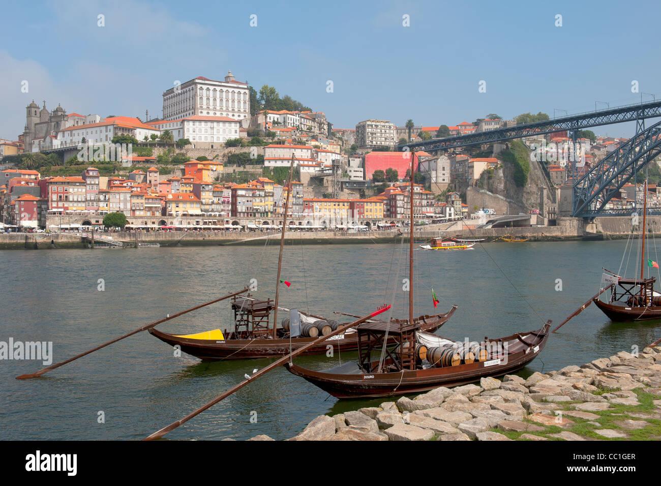 Rabelo boats anchored at Vila Nova de Gaia in front of Ribeira district, Porto, Portugal, Unesco World Heritage - Stock Image