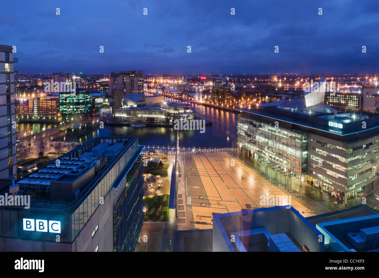 View over Salford Quays from MediaCityUK with the BBC studios in the foreground, Salford Quays, Manchester, UK - Stock Image