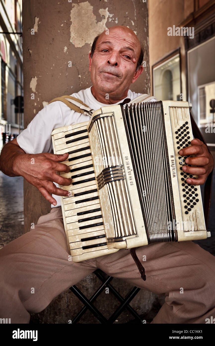 Street musician busking in Bologna, Italy - Stock Image