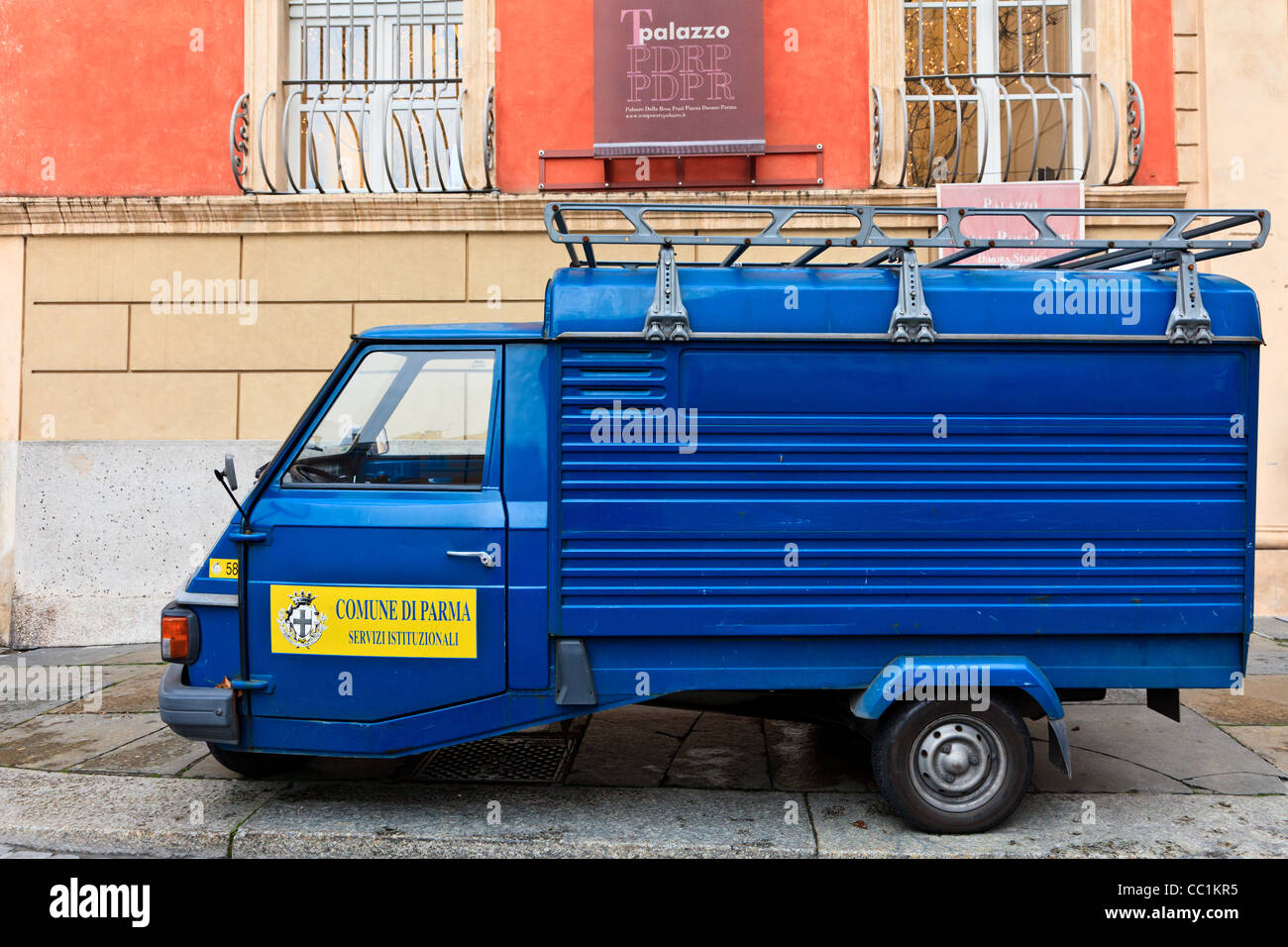 A three wheeler township delivery van parked on a street in Parma, Italy - Stock Image