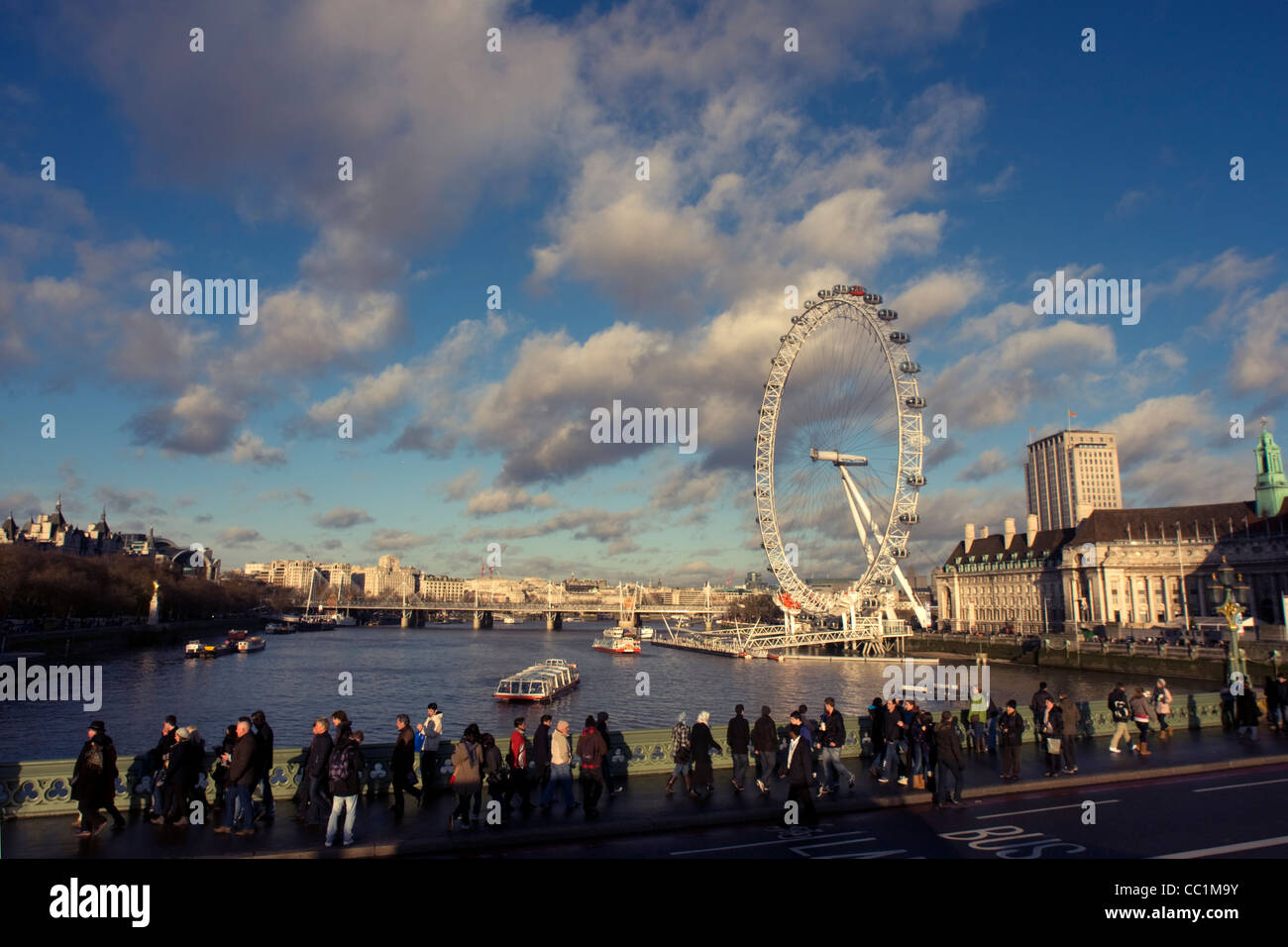 View over the River Thames, London Eye and pedestrians walking along Westminster Bridge, London, England, UnitedStock Photo