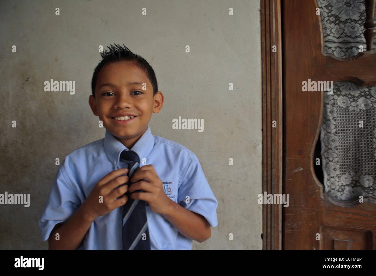 Young schoolboy getting ready for school in Gracias Lempira Honduras - Stock Image