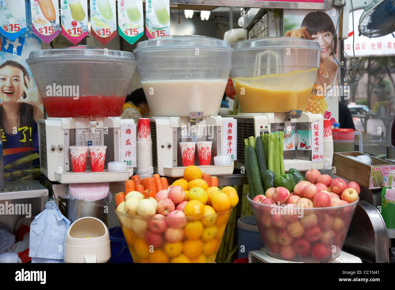 fresh chilled fruit juices for sale on a stall hong kong hksar china asia - Stock Image