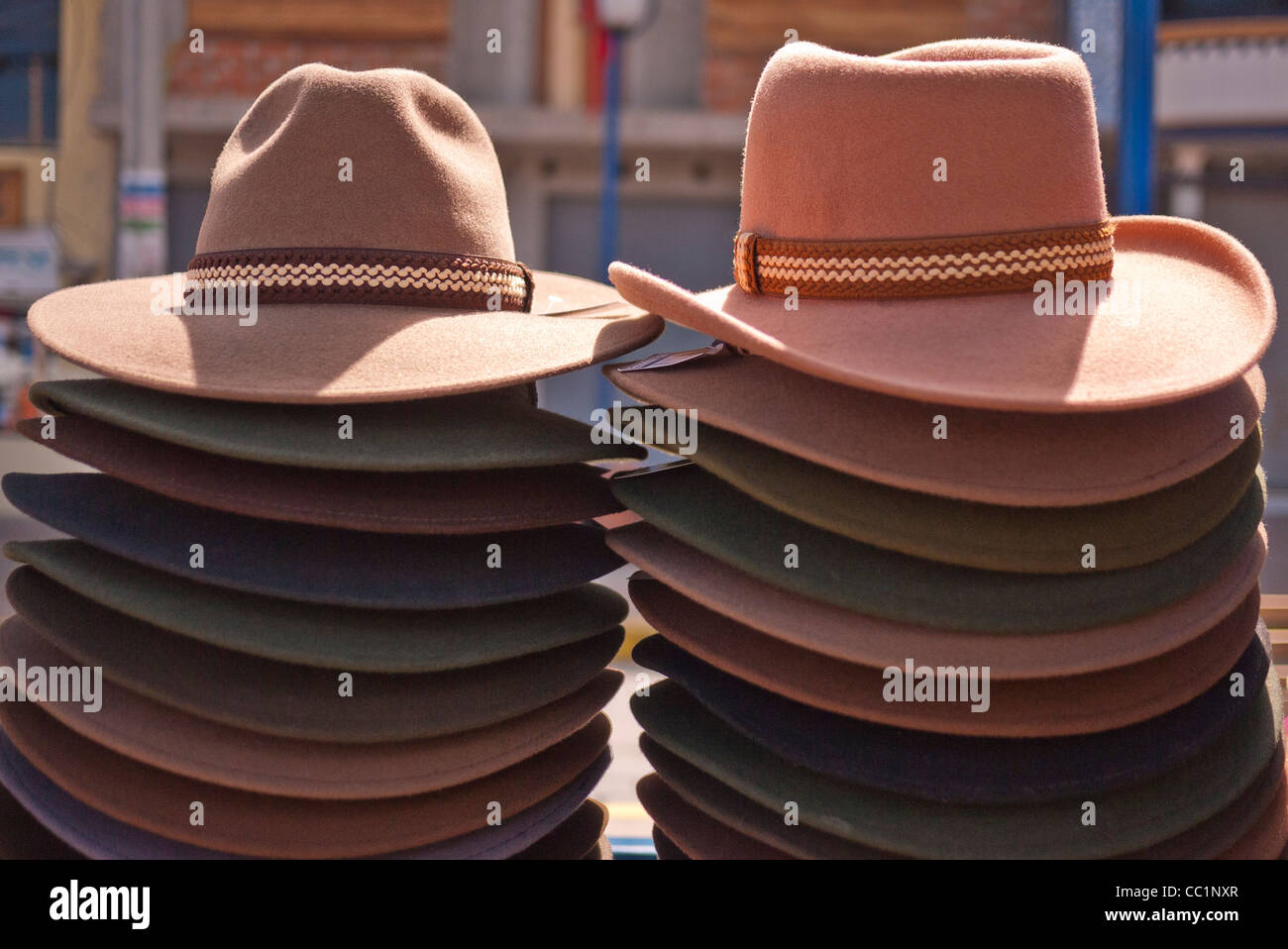3096e0ca04835f Two stacks of authentic cowboy hats on display, for sale, in the open air  market in Otavalo, Ecuador.