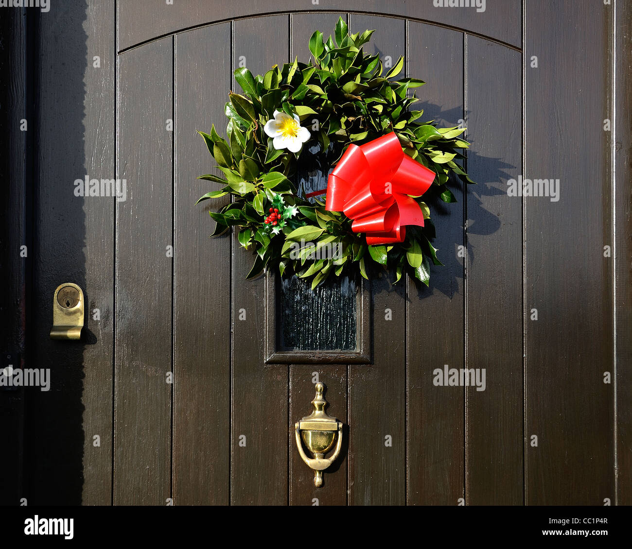 A traditional christmas wreath on the front door of  England Stock Photo