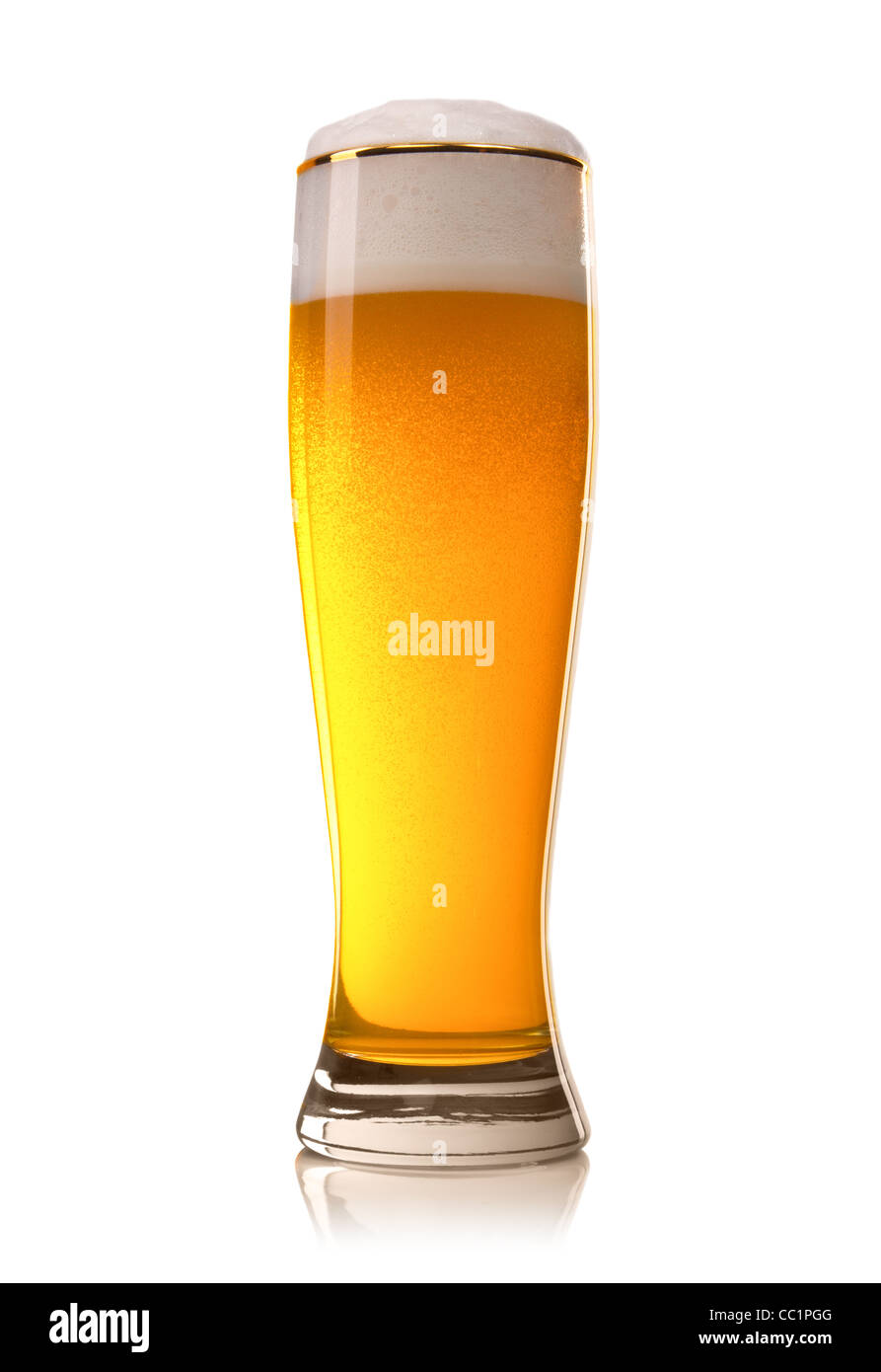 Beer into glass isolated on white - Stock Image