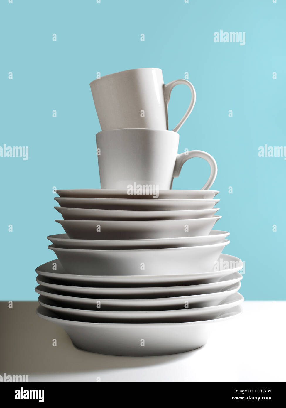 White Dishes Stacked - Stock Image