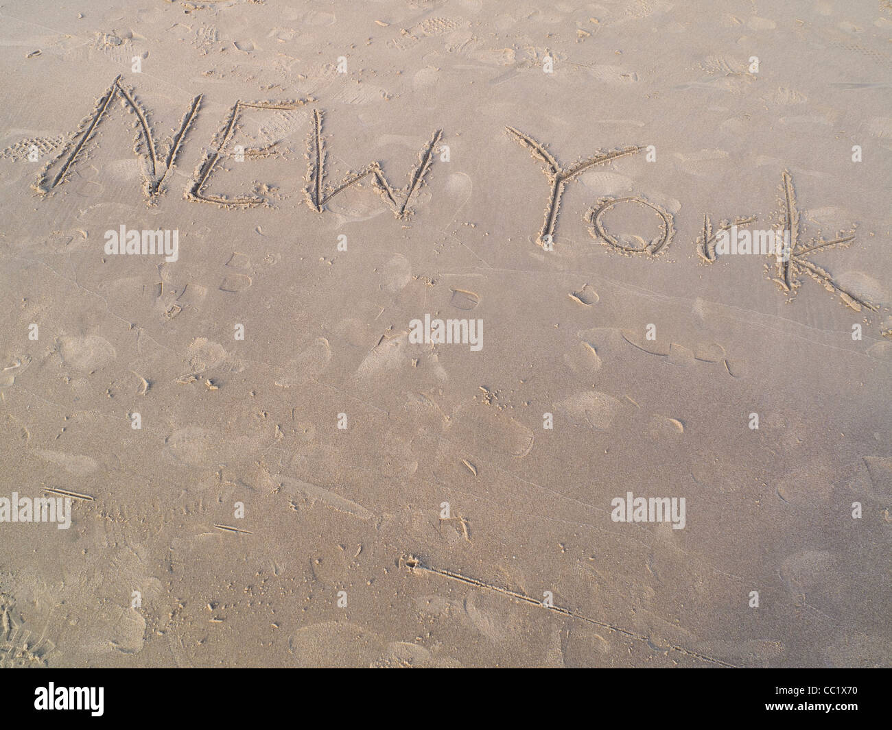 New York written in the sand - Stock Image