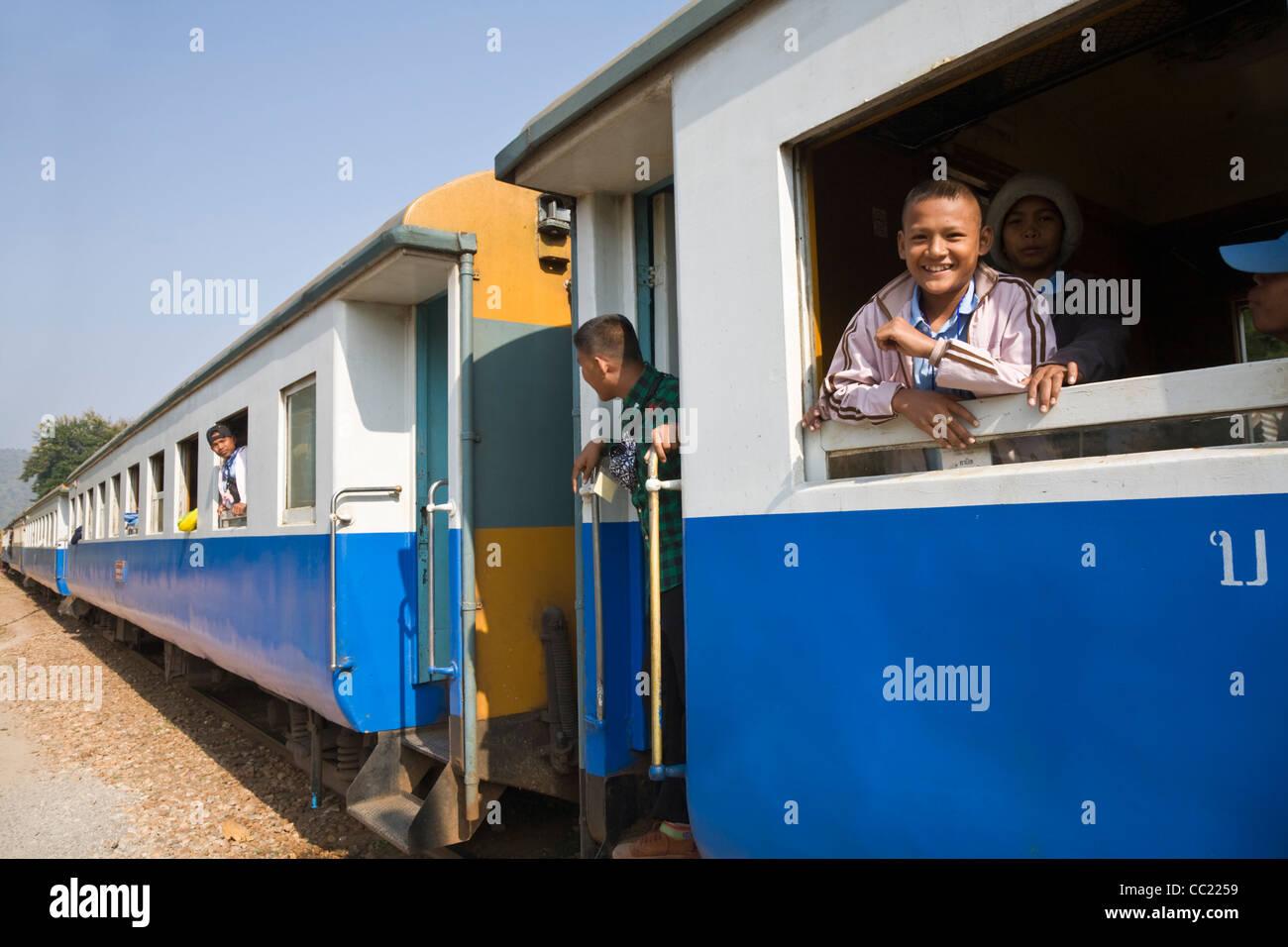 Train ride on the Thailand-Burma railway (also known as Death Railway).  Kanchanaburi, Kanchanaburi, Thailand - Stock Image