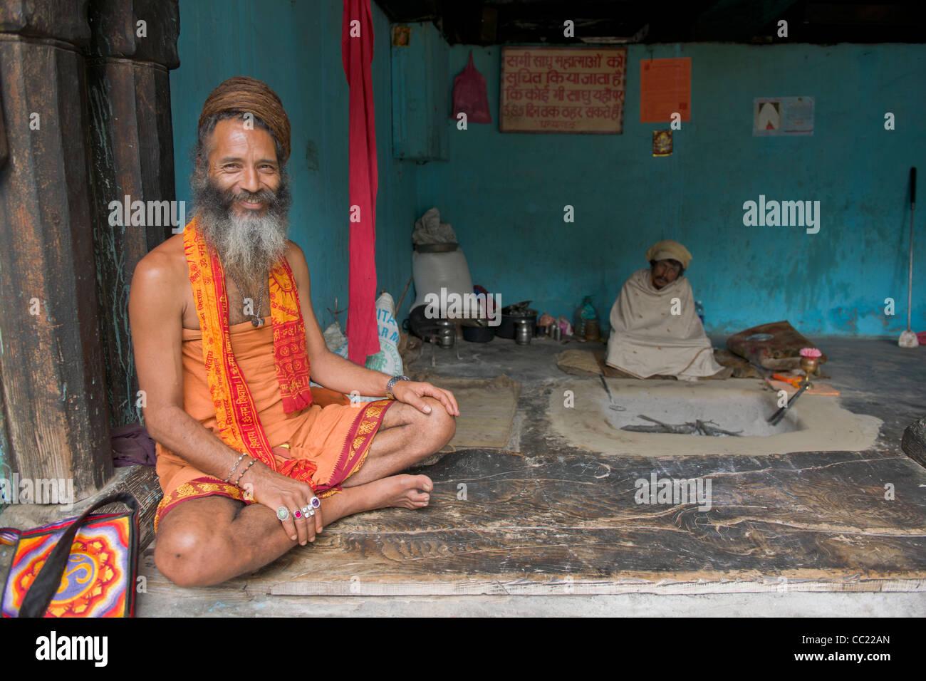 Motorcycle Baba, a Sadhu from the Juna Akhara, in an ashram at the Vashisht temple, Manali, Himachal Pradesh, India - Stock Image