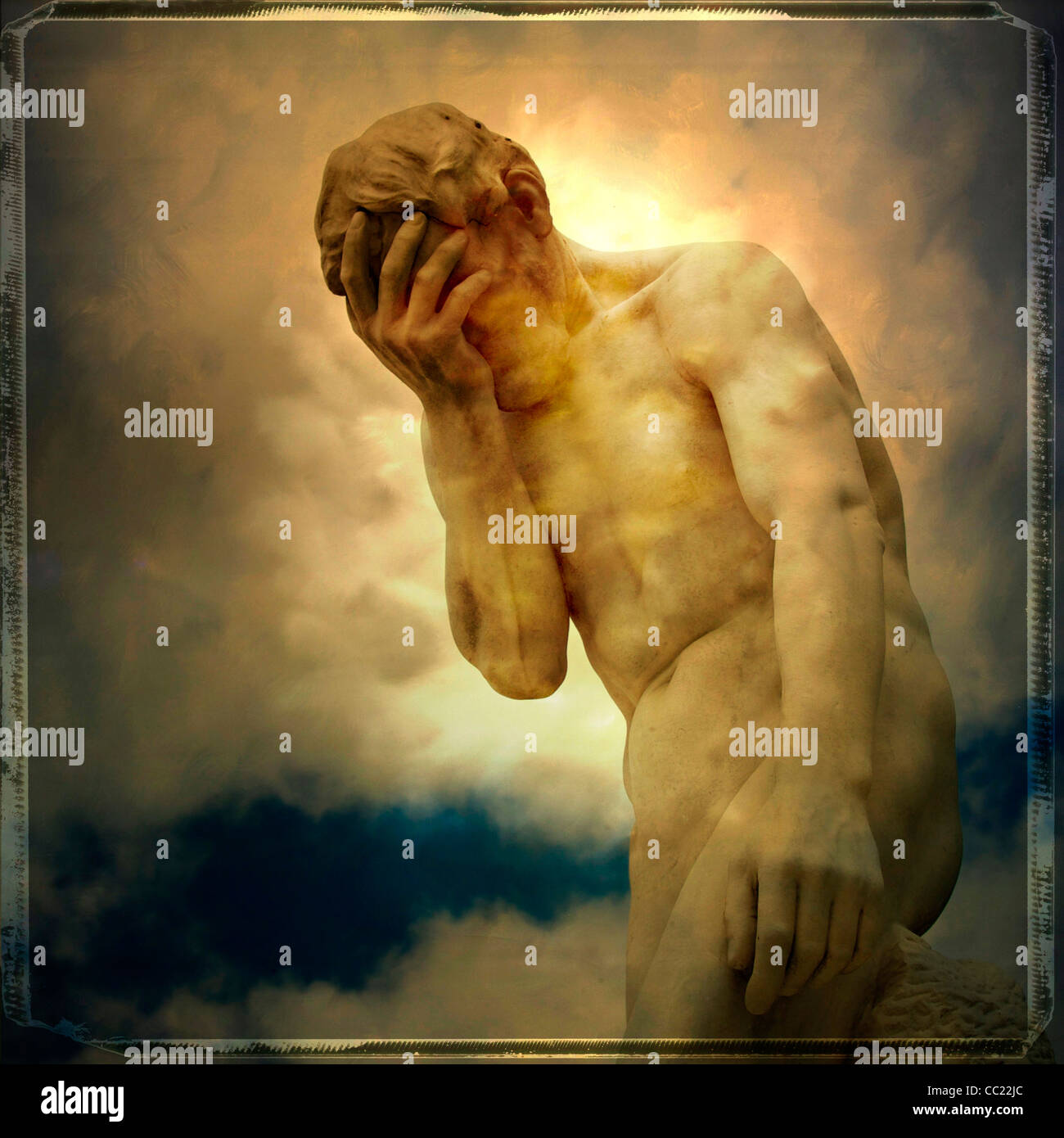 Statue of man covering face - sorrow, sadness, mental health or despair concept - Stock Image