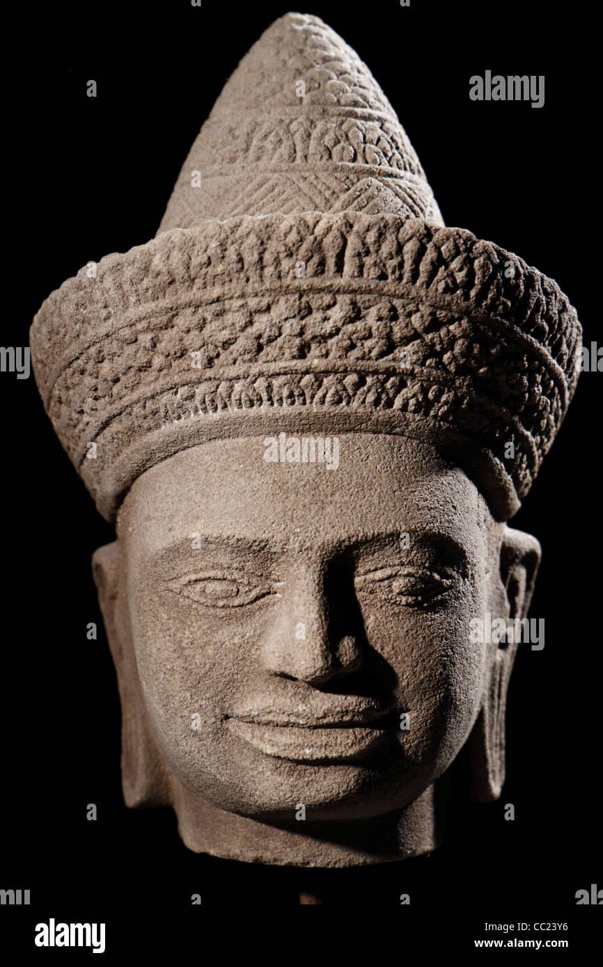 Khmer style sandstone  head of  Hindu deity Vishnu - Stock Image
