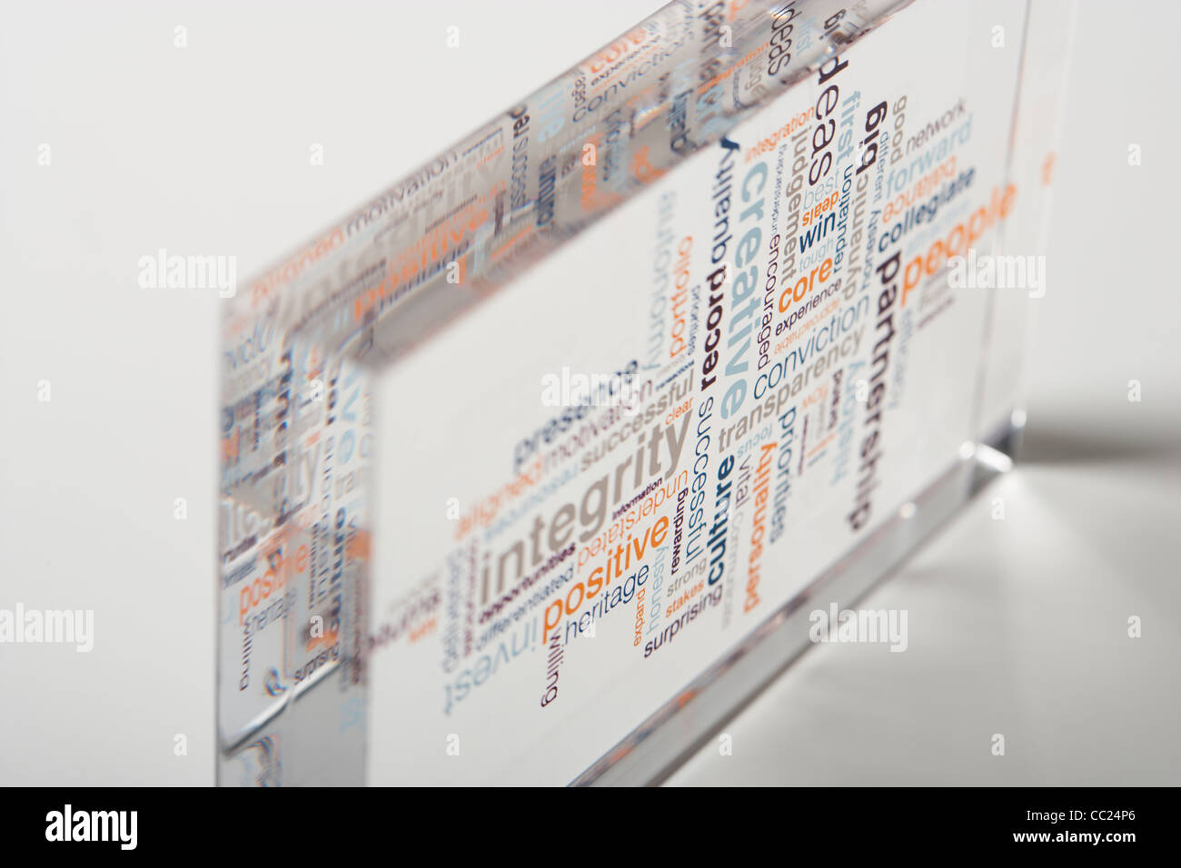 clear acrylic block with corporate values - Stock Image