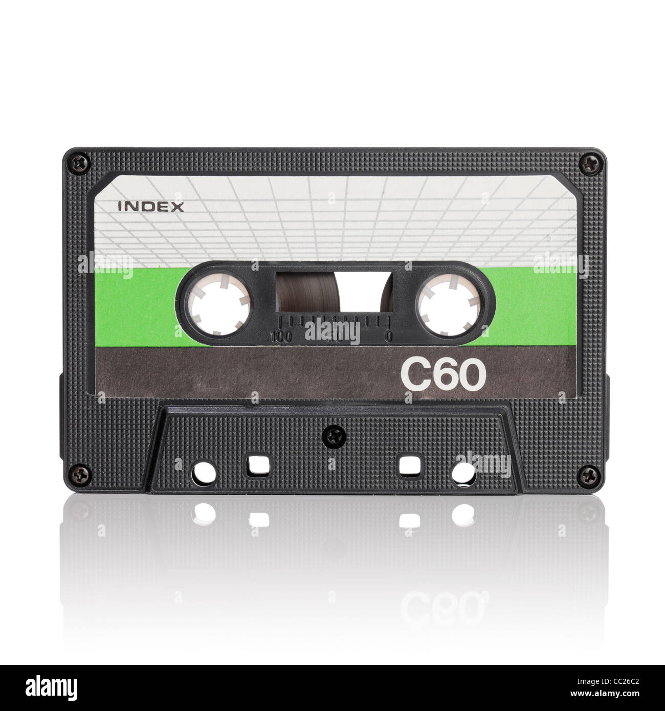 Vintage c-cassette audio tape on white with natural reflection. - Stock Image