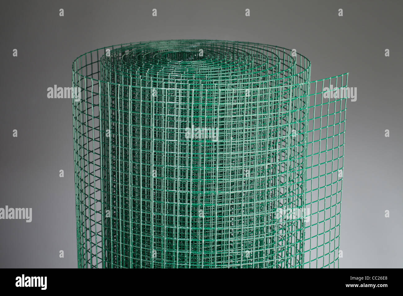 Coated green metallic wire mesh used in gardening by protecting plants from animals. Stock Photo