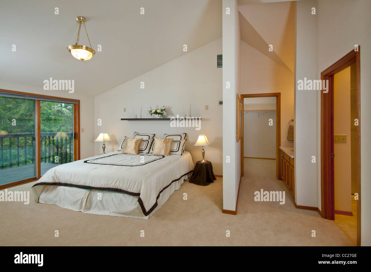 Master Bedroom In Luxury House Showing Walk In Closet And Part Of