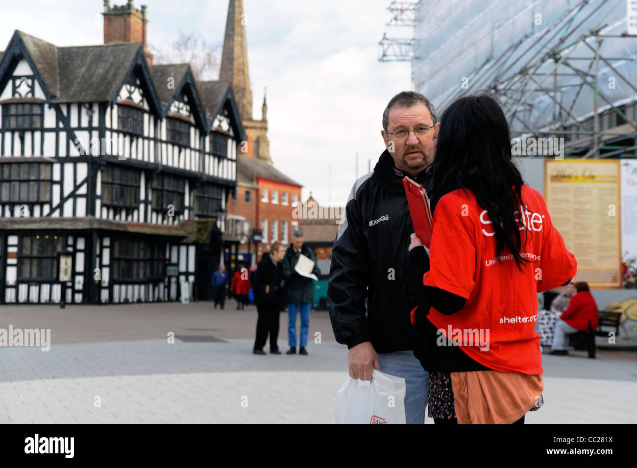 Shelter homeless charity worker fund raising in Hereford City Centre, UK. - Stock Image