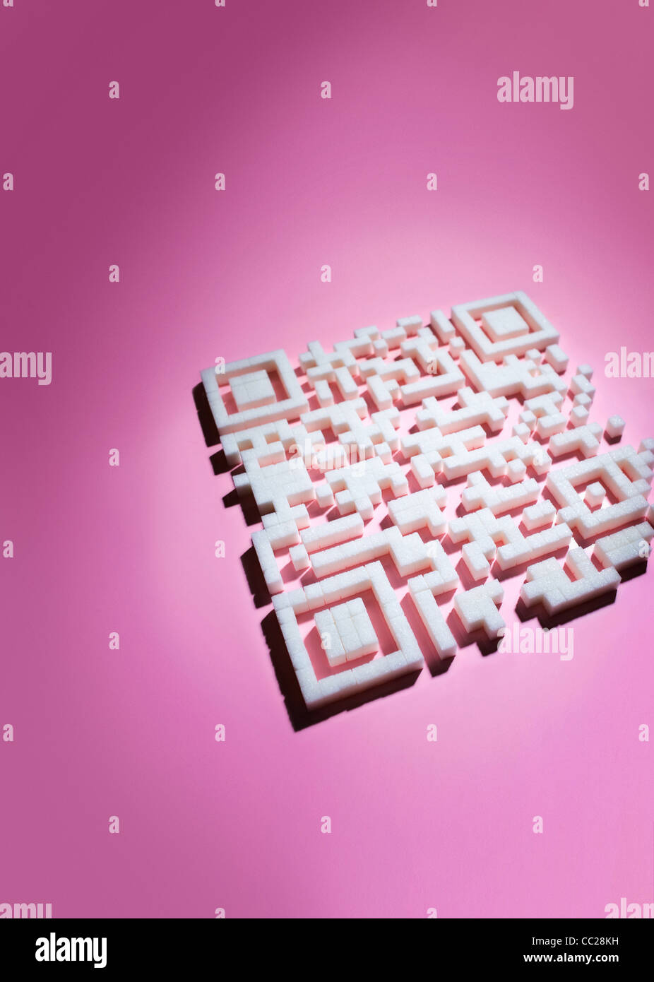 A scan code made of sugar cubes - Stock Image