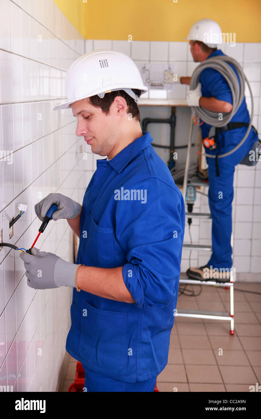 Electricians Wiring Bathroom Stock Photos In Couple Of A Building Image