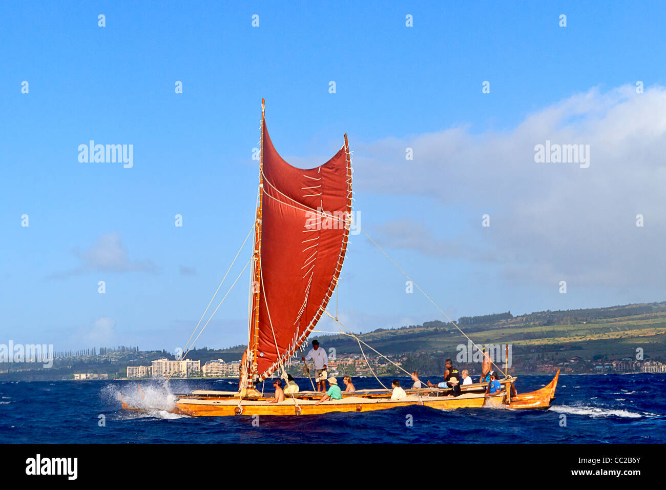 Mo'olele, replica of an ancient Hawaiian war canoe, sails in waters off Maui, Hawaii, - Stock Image