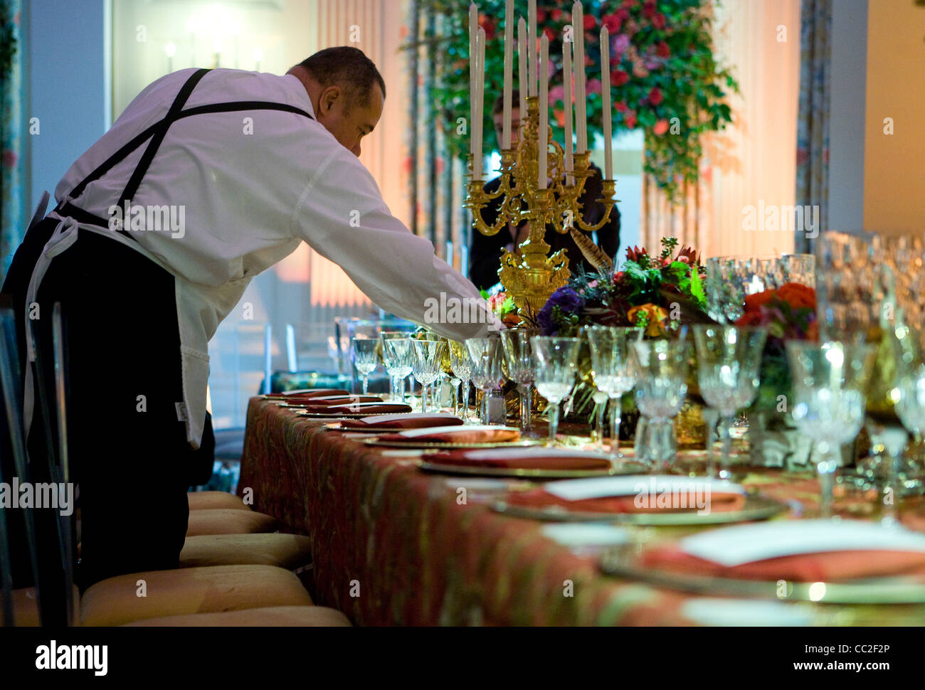 Preparations in the State Dining Room of the White House for the China state dinner. - Stock Image