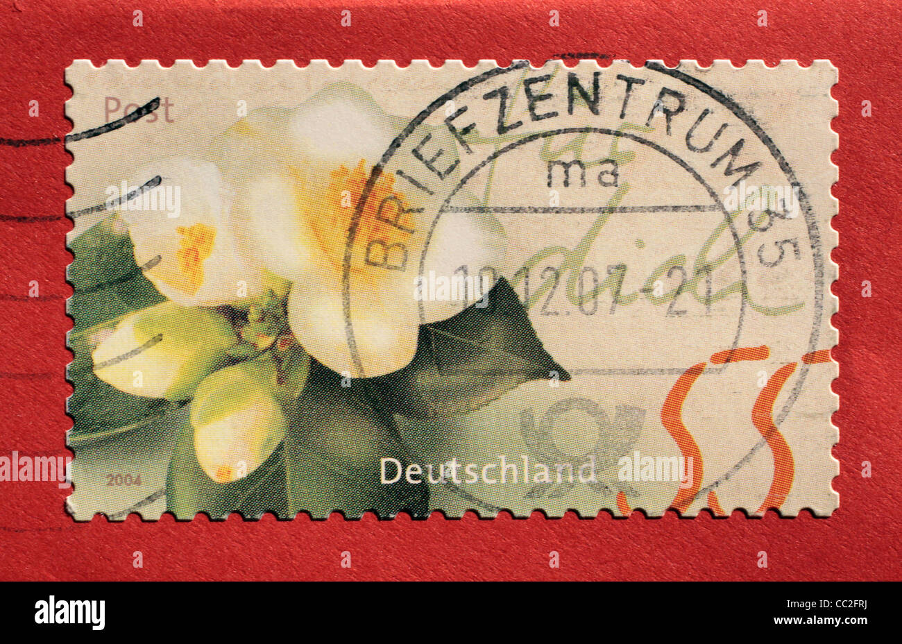 Postage stamp from Germany with red background - Stock Image