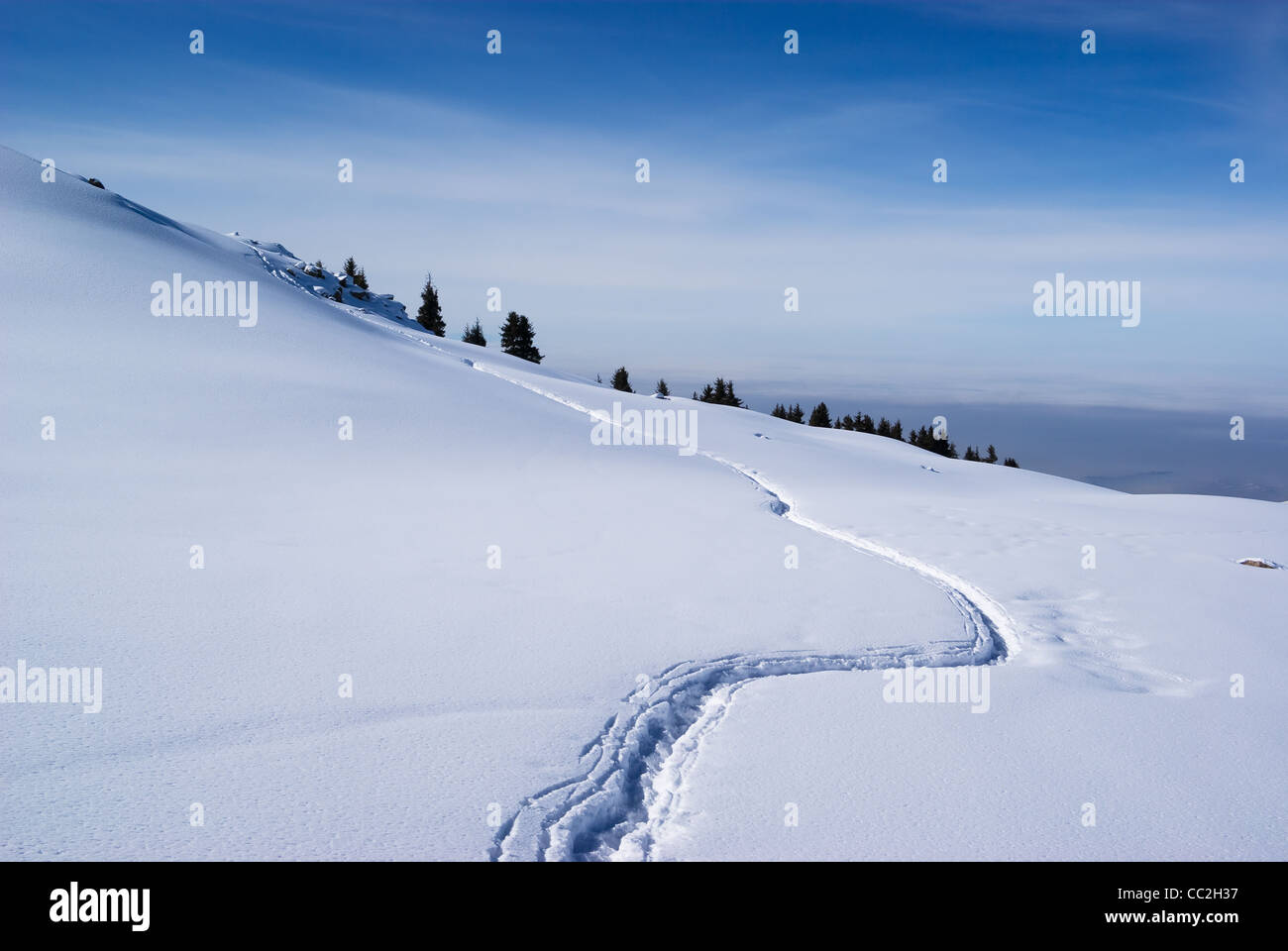 Footpath in winter mountains - Stock Image