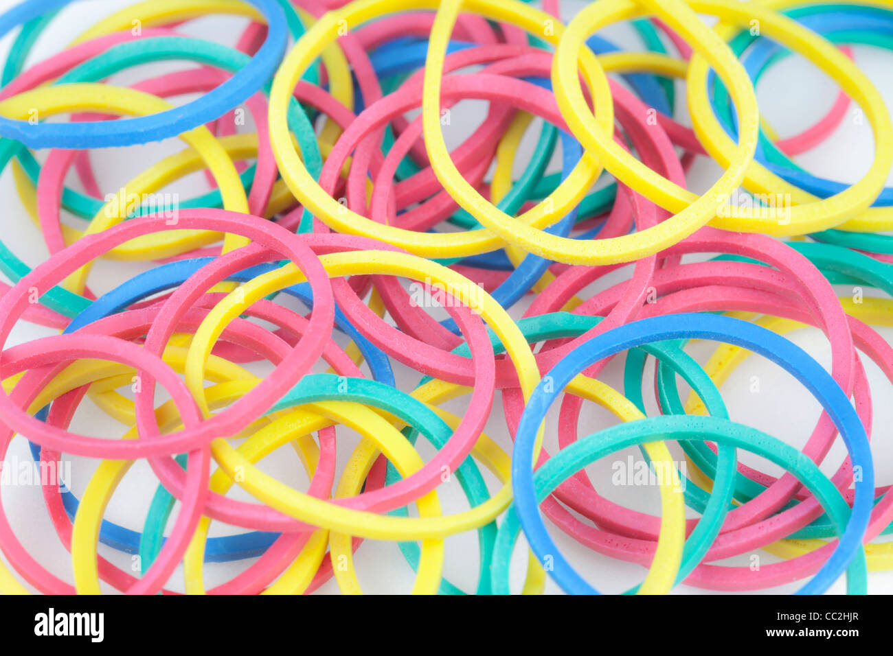 Colourful elastic bands - Stock Image