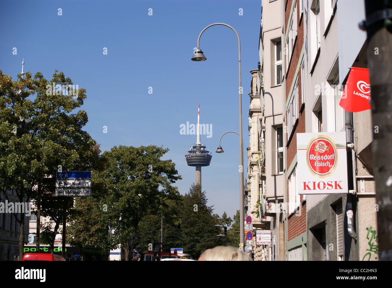 A street scene with 'Colonius' television tower, fernsehturm, Koln, Nordrhein-Westfalen, Germany - Stock Image